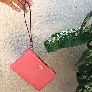 Pink coach zip up hand wallet